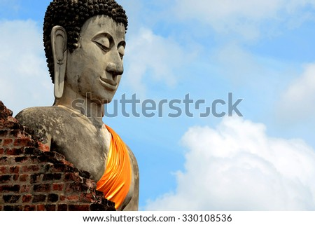 Picture from world heritage Ayutthaya site, Thai old Buddha face sculpture at Wat Yai Chaimongkol temple Ayutthaya Thailand