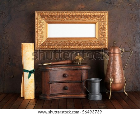 Picture gold frame with ancient subjects. Still-life.