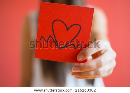 Picture icon paper heart in hand - stock photo