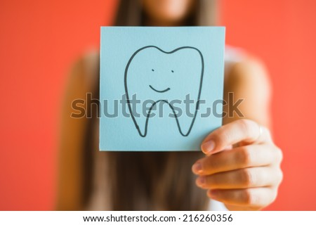 Picture icon tooth in his hand - stock photo