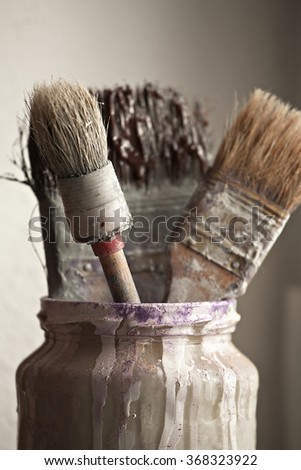 Picture jars with brushes for painting and repair - stock photo