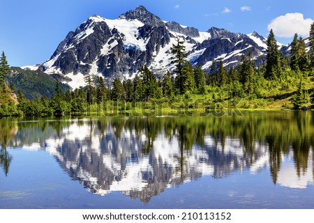 Picture Lake Evergreens Mount Shuksan Mount Baker Highway Snow Mountain Trees Washington Pacific Northwest USA  - stock photo