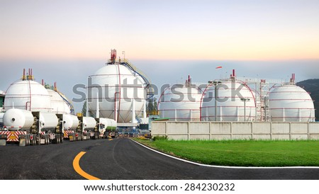 Picture Montage spherical gas tanks. Will be paid to the truck to deliver all the gas stations sell gas. - stock photo