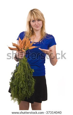 Picture of a beautiful smiling girl holding bunch of carrots against background. Isolated over white background. - stock photo