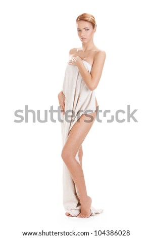 picture of a beautiful young female model posing in towel isolated over white background