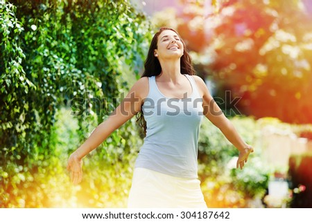 Picture of a beautiful young woman enjoying the summer - stock photo
