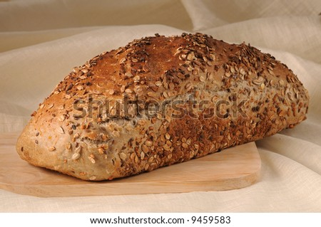Picture of a bread on a wooden plate - stock photo