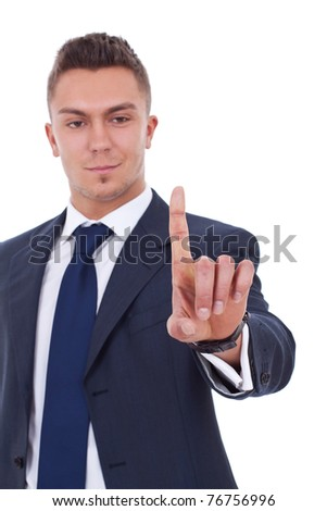 picture of a business man pressing an imaginary button over white - stock photo