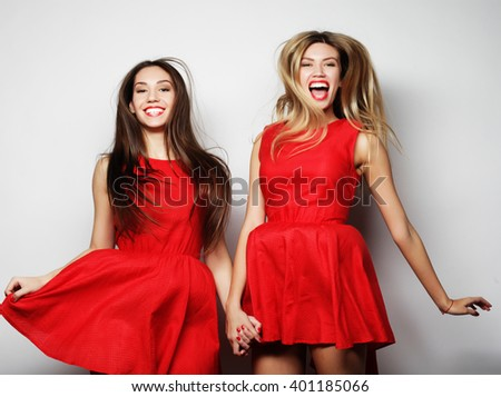 Picture of a charming young girls in red dress on white background - stock photo