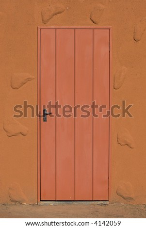 Picture of a closed door and the wall surrounding it.