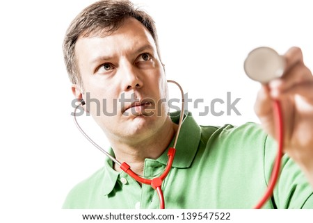 Picture of a doctor with serious face holding a stethoscope