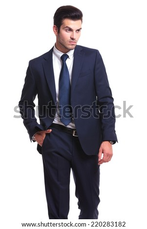 Picture of a elegant business man looking away from the camera while holding one hand in pocket