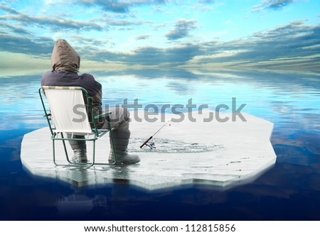 Picture of a fisherman catching a fish on ice. - stock photo
