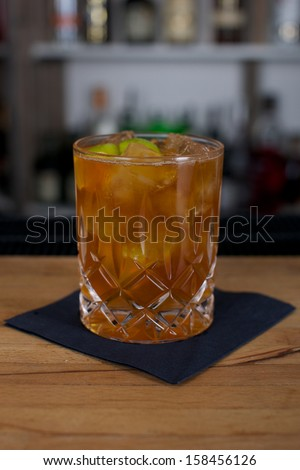 Picture of a fresh cocktail on a bar desk - stock photo