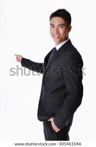 picture of a happy business man presenting something on a white background - stock photo