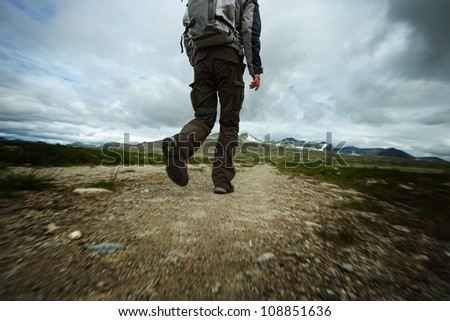 PIcture of a hiker walking - stock photo