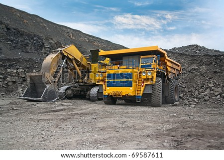 picture of a large mining trucks and excavators - stock photo