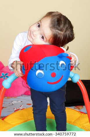 Picture of a little girl hugging her toy - stock photo