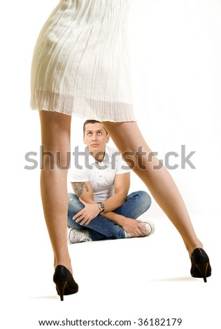 picture of a man looking at a woman in dress
