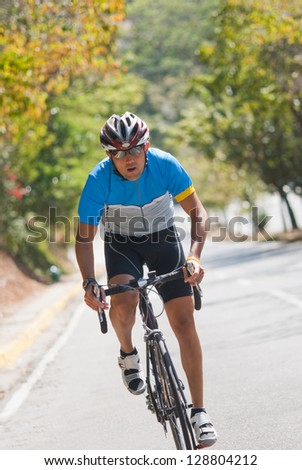 Picture of a man riding a racing bicycle - stock photo