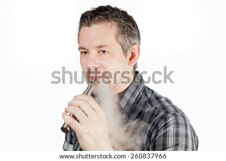 Picture of a man smoking on a e cigarette with smoke being exhaled