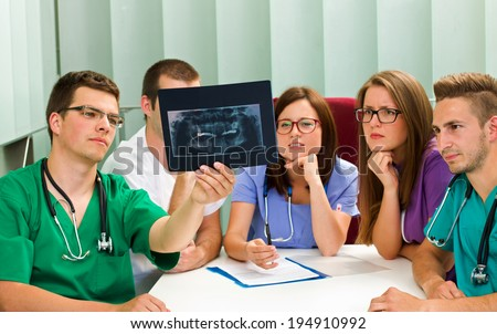 Picture of a medical team analyzing an X-ray - stock photo