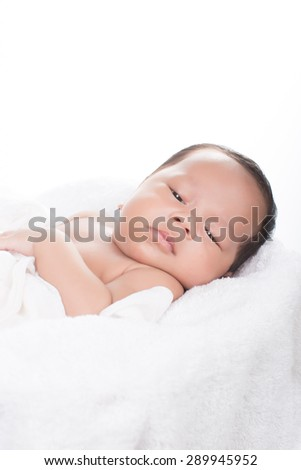 picture of a newborn baby on white blanket