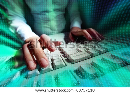 Picture of a person typing at a keyboard with matrix effect put over - stock photo