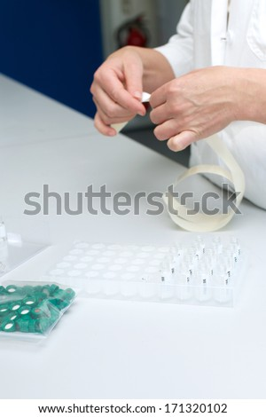 Picture of a person working in a lab - stock photo