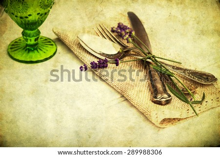 picture of a place setting with antique cutlery - stock photo
