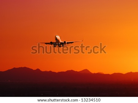 Picture of a plane taking off at sunset