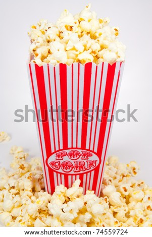 Picture of a popcorn holder with popcorn in front