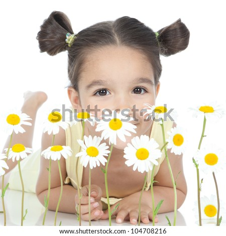 Picture of a pretty smiling little girl with daisies over white background - stock photo