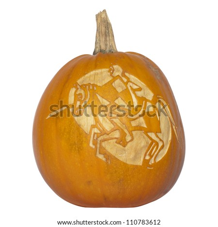 Picture of a pumpkin, with silhouette of a knight and horse cut in the surface Isolated, white background - stock photo