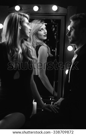 Picture of a sexy woman flirting with handsome man - stock photo
