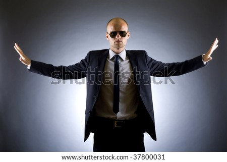 picture of a successful businessman with arms open