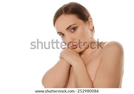 Picture of a upset gorgeous nude woman looking to the camera isolated - stock photo