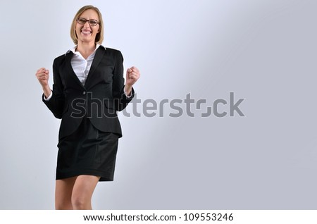 Picture of a very happy businesswoman winning - stock photo