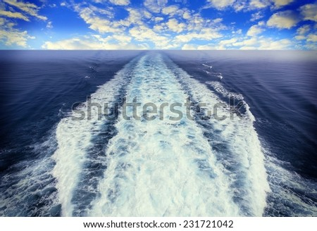 Picture of a view of a boat trace in the sea - stock photo