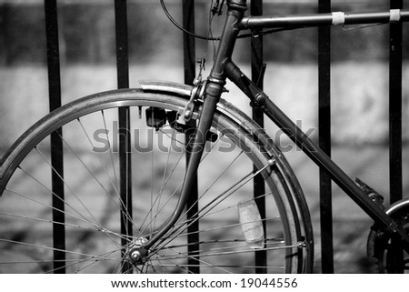 Picture of a vintage bicycle in black and white. - stock photo