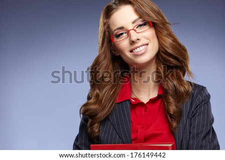 picture of a young attractive businesswoman with folders - stock photo
