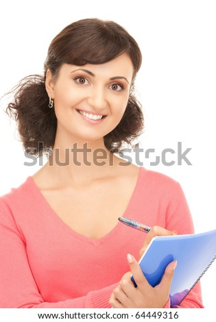picture of a young attractive businesswoman with notebook