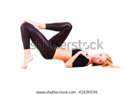 Picture of a young beautiful fitness girl on floor. Isolated on white.