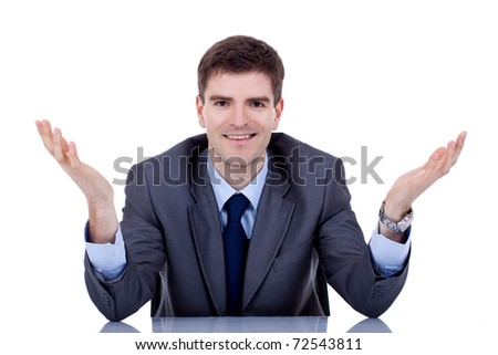 picture of a young business man at his desk welcoming, over white - stock photo