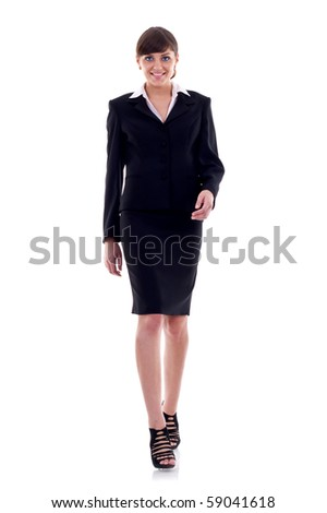 picture of a young business woman walking towards the camera - stock photo