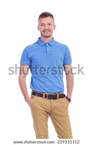 picture of a young casual man with his hands in his pockets, smiling for the camera. isolated on a white background - stock photo
