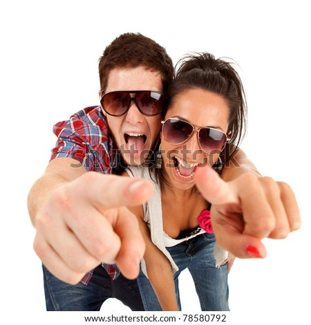 picture of a young couple pointing to you and screaming - stock photo