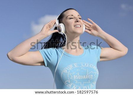 picture of a young woman has the joy of listening music - stock photo