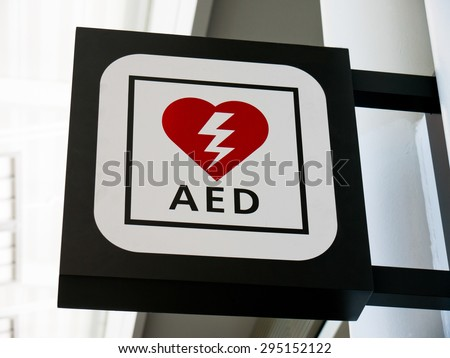 Picture of AED Emergency Defibrillator sign mounted to a wall - stock photo