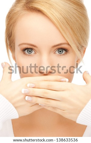 picture of amazed woman with hand over mouth. - stock photo